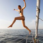 jumping-off-sailboat